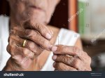 stock-photo-old-woman-trying-to-thread-a-needle-464131898.jpg